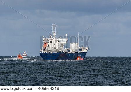 Merchant Vessel  - The Freighter Follows Waterway