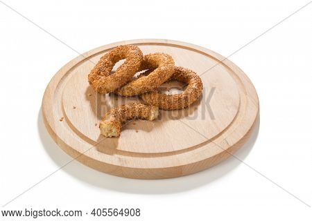 Traditional middle eastern sesame ring cookies called kandil simidi on wooden plate