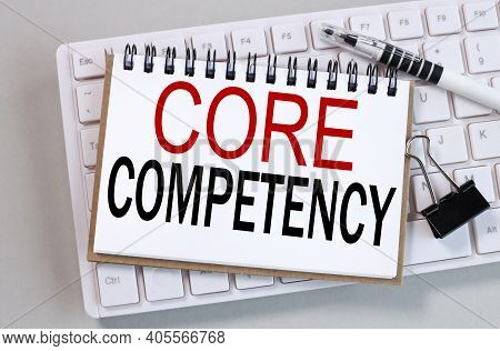 Core Competency, Text On White Notepad Paper On Gray Background