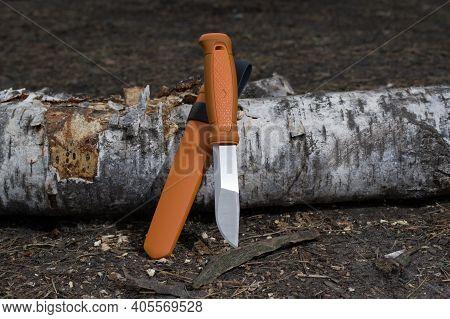 Fixed Blade Knife. Knife With Orange Handle And Plastic Sheath. Orange Case And Knife.