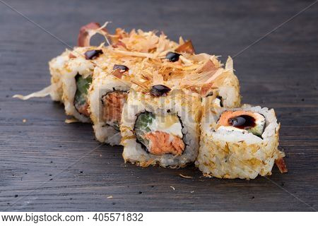 Traditional Japanese Sushi With Salmon, Soft Cheese, Avocado And Tuna, Garnished With Sauce. Japanes