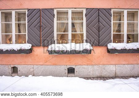 Finland, Helsinki. January 26, 2021 Windows And Facade Of An Old Building In Helsinki. Close-up. Hig