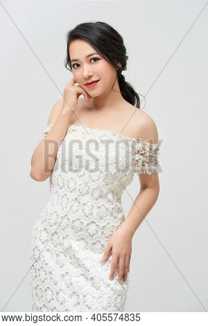 Beautiful Bride Dressed In A White Dress On White Background.