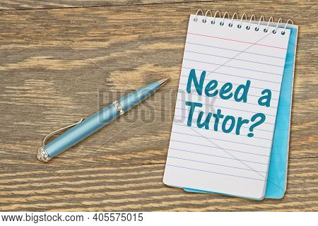 Need A Tutor Message On Retro Lined Paper Notepad On A Weathered Wood Desk With A Pen