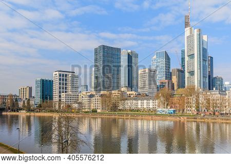 Frankfurt Skyline On Sunny Day. River Main In The Foreground. High-rise Buildings From The Financial
