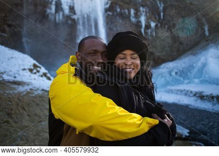 Hauyfoss Waterfall, Iceland - 03.11.2018: Love And Happiness Concept. Close Up Portrait Of Happy Afr