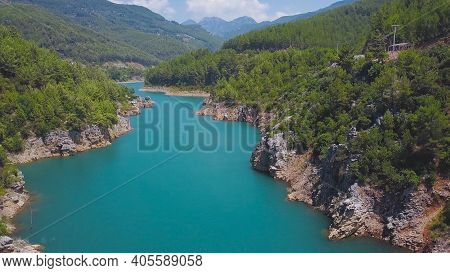 Top View Of Beautiful Turquoise River In Mountain Valley On Sunny Day. Clip. Beautiful Mountain Land