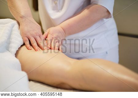 Body Care Concept. Special Anticellulite Treatment. Masseur Makes Anticellulite Massage Young Woman