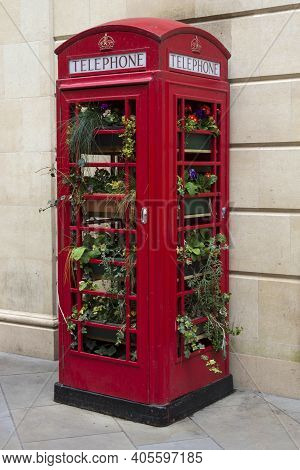 Bath, Uk - April 10, 2019. Red Public Phonebox Filled With Plants In The City Centre Of Bath. Bath,