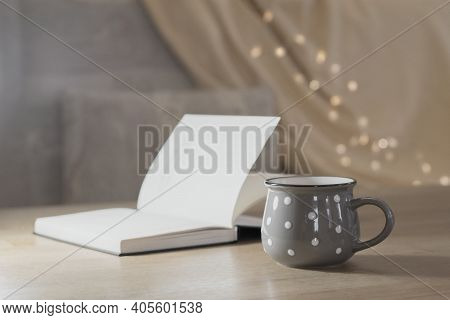 Cup Of Hot Tea And Book On The Table, Cozy Home Interior Background