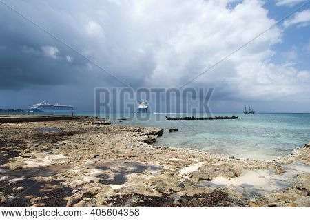 The View Of Rocky Grand Cayman Island Coastline And Different Ships In A Background (cayman Islands)