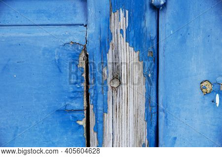 Wooden Background Of Old Shutter With Peeling Paint