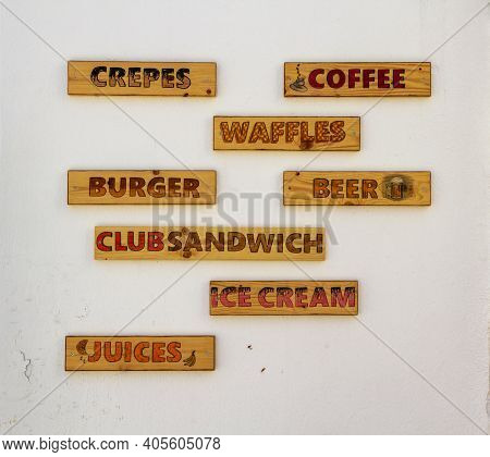 Skiathos, Greece - August 13, 2019. Wooden Signs On Cafe Wall, Skiathos Town, Greece, August 13, 201