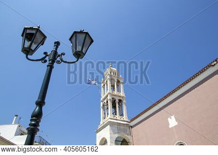 Skiathos, Greece - August 13, 2019. Bell Tower With Clock On Top Of Hill, Skiathos Town, Greece, Aug