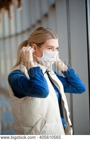 Coronavirus And Air Pollution Pm2.5 Concept. Woman Using Mask For Protection Pm2.5 In Airport Termin