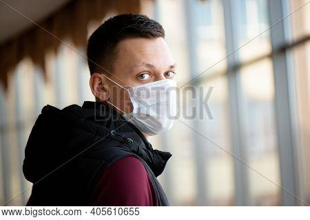 Sick Man Wearing A Face Mask In Quarantine Zone. New Coronavirus 2019-nkov Infection Or Wuhan Corona
