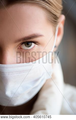 Portrait Of A Young Girl In A Protective Mask On Her Face. The Concept Of Infectious Disease, Corona