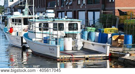 Portland, Maine, Usa - 25 July 2020: Fishing And Lobster Boats Docked In An Inlet In The City Of Por