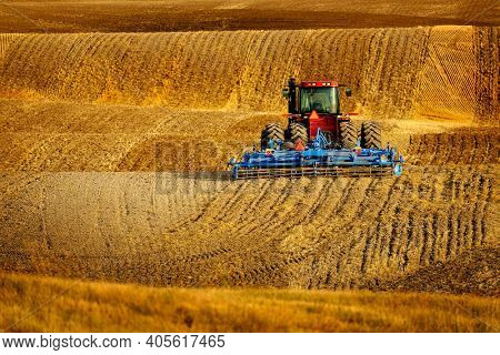 Tractor Equipment Farming Ground Harvesting crops in fall Autumn Harvest