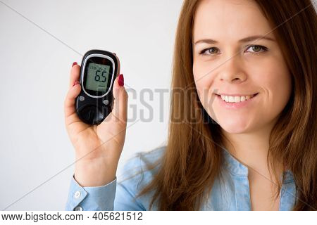 The Diabetic Measures The Level Of Glucose In The Blood. Diabetes Concept. Diabetic Supplies On A Wh