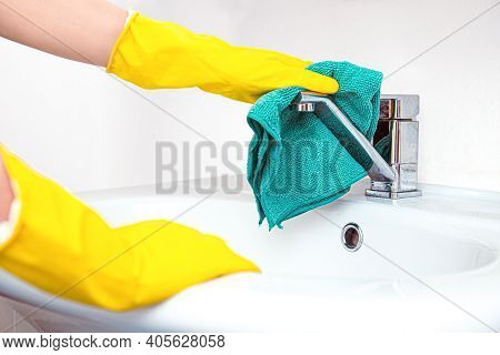 Clean Up Your House. Woman Doing Chores In Bathroom, Hands In Yellow Gloves Cleaning Of Water Tap, S