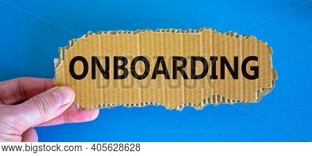 Onboarding Symbol. The Concept Word 'onboarding' On The Piece Of Cardboard Between Fingers. Beautifu