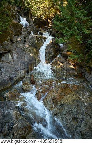 Pacific Northwest Deception Falls Washington vertical. Deception Falls in the Cascade Mountains. Washington State, USA.
