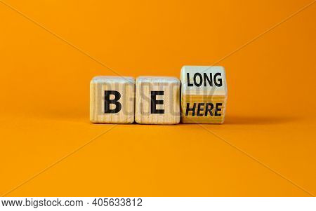 Be Here Belong Symbol. Turned A Cube And Changed Words 'be Here' To 'belong'. Beautiful Orange Backg
