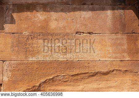 Aihole, Karnataka, India - November 7, 2013: Lad Khan Temple. Closeup Of Ancient Script Chiseled Int