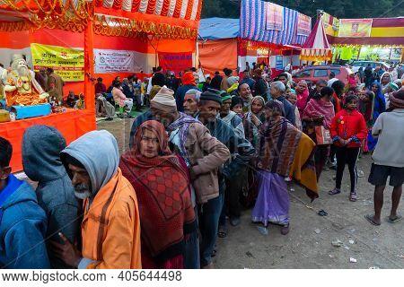 Kolkata, West Bengal, India - 12th January 2020 : Hindu Devotees Queing Up For Roti, Indian Food, At