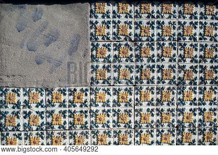 Traditional old tiles wall on street painted tin-glazed, azulejos ceramic tilework. Porto, Portugal.