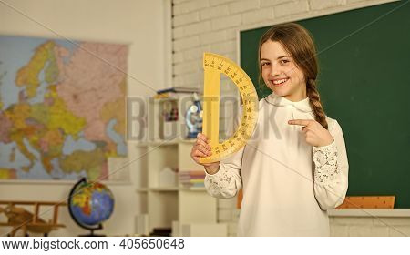 Lets Study Together. Learning To Use Protractor. Back To School. High School Student Learning Geomet