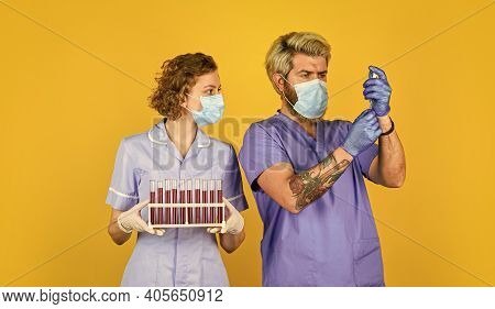 Creating Vaccine. Blood Samples. Doctors Respirator Mask. Infection Vaccine And Blood Test. Medical