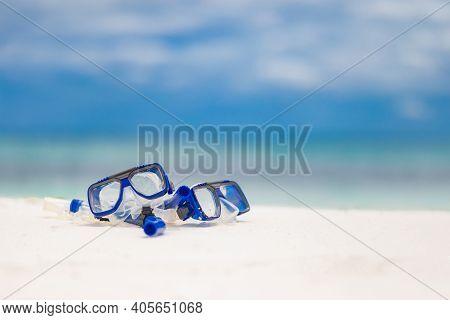 Mask And Snorkel White Sandy Beach; Selective Focus With Endless Sea Ocean Horizon. Summer Fun, Wate