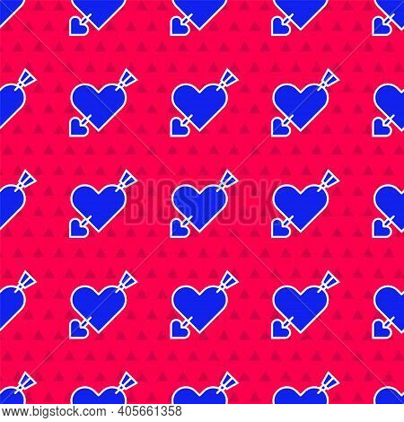 Blue Amour Symbol With Heart And Arrow Icon Isolated Seamless Pattern On Red Background. Love Sign.