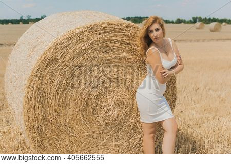 Natural Modern Plus Size Woman With Full Hips, Pretty Figure In White Costume At Field. Concept Of F