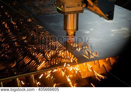 Automatic Cnc Laser Cutting Machine Working With Sheet Metal With Sparks At Factory, Plant. Metalwor