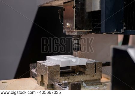 Turning Milling Machine Cutting White Acrylic Artificial Stone Workpiece At Factory, Exhibition: Clo