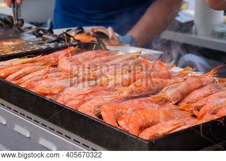 Process Of Cooking Fresh Red Langoustine Shrimps, Prawns On Grill At Summer Local Food Market - Clos