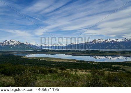 Perito Moreno Glacier With Dramatic Clouds Over The Landscape Of Lago Roca At Glacier National Park