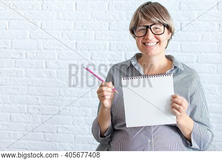 Mockup White Sheet Pregnant Woman In Office Dress, Holding Blank White Card Near Belly, Place For Te