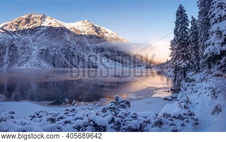 Winter Mountain Landscape. Beautiful Ice Lake In Mountains. Scenery Winter. Fir Trees On Snowy River