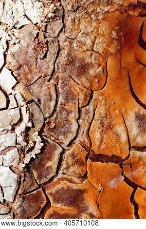 Texture Of Dry And Cracked Earth With Striking Colors On The Banks Of The Rio Tinto.