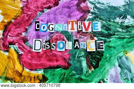 Cognitive Dissonance  Text From  Cut  Letters On Abstract Strokes Colorfull Background. Headline - C