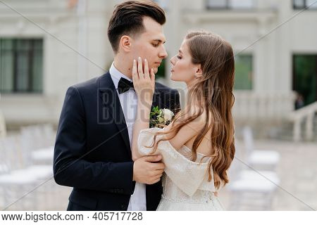 Beautiful, Gentle And Happy Bride And Groom. Woman Gently Touches Mans Face
