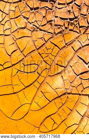 Texture Of Dry And Cracked Earth On The Banks Of The Rio Tinto