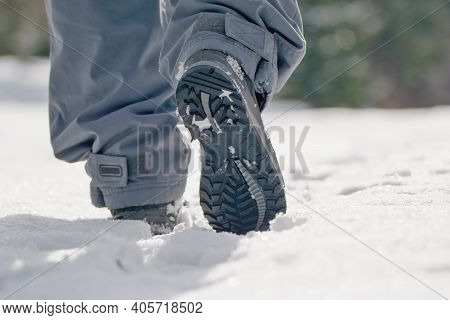 Man Walking In The Fresh White Snow