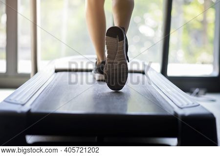 A Close Up Of Woman Runner Shoes On Running Machine Or Treadmill In Fitness Gym, Healthy And Exercis