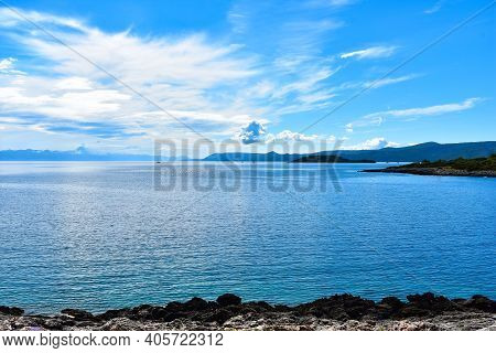 Beautiful Adriatic Sea In Croatia. Blue Calm Water, Cloudy Sky, Stony Coast, Nice