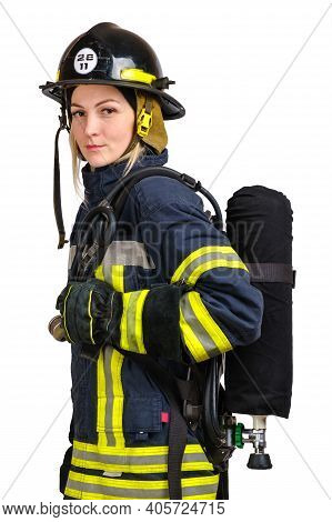 Young Caucasian Woman In Uniform Of Fireman Posing In Profile With Air Cylinder Assembly On Her Back